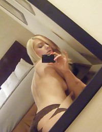 Picture collection of a hot amateur chick posing in a hotel room