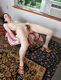 The slim chick is modeling her hairy pussy and her luscious alabaster skin.