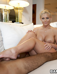 Hottie gives big cock footjob