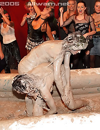 Two hot lesbians babes getting crazy mud wrestling