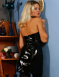 Blonde in black latex