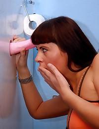 Brunette teenie sucking on a public toilet