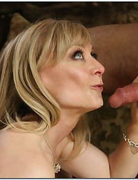 Milf in stockings blows him