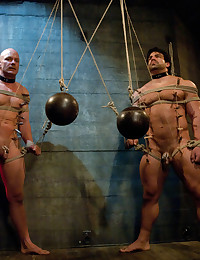 Two muscle studs are getting heavy corporal and fucked during a live show.