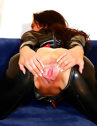 Crotchless latex catsuit on brunette