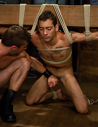 Muscular man in gay bondage