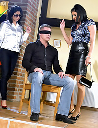 Blindfolded dude shagging two willing hotties hard