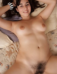 Horny Wara tease her pink bush on the sofa. Running her fingers up and around her lips and pulling on her tufts of hair really make her wet!