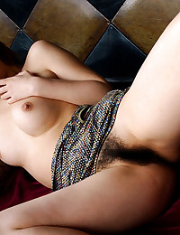 Hairy Asian pussy behind panties