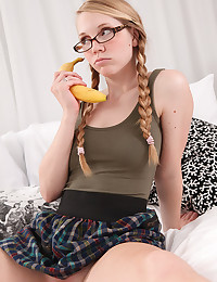 Pigtailed schoolgirl in glasses