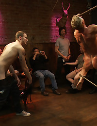 Perfect bodied blond hunk is humiliated in a bar full of strangers as they flog him, make him suck cock and fuck him until he can't take any more.