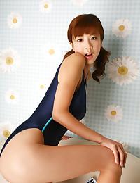 Luscious Asian Vixen In Her Swimsuit