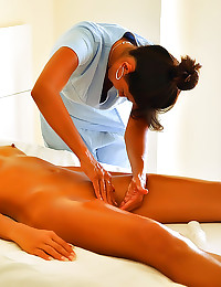 Oiled up lesbian massage of b...
