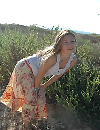 Emily 18 - Smiling teen babe exposing her perfect buttocks outdoors