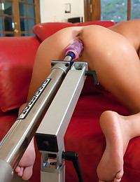 Pretty girl loves dildo machine