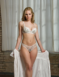 Liz is back, this time looking hot in her sexy white lingerie set.