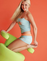 Alison Angel - Blonde honey exposes her curvy body on a lemon colored chair