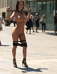 Penthouse Pet Fanceska Jaimes has her big round ass caned in a public square, then she is fisted in her ass, fucked, and made to lick pussy in public