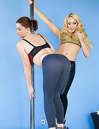Girls in skintight pants pole...