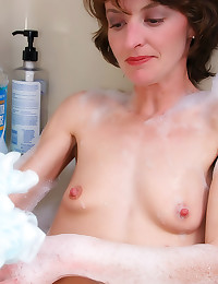 Skinny mature in the bath