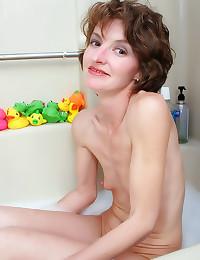 Skinny mature in the bath