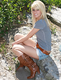 Beautiful blonde in clothed tease