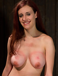 Redhead with tied up titties