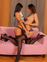 High heels hotties in stockings grind and lick all over each other