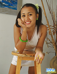 Adorable Asian teen smiling