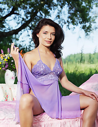 Kayla B looks stunning in her purple lingerie today.