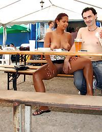 Daring girl publicly sucking his solid wiener