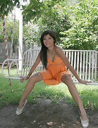 True Tere - Leggy dark-skinned teen latina wearing a very revealing orange dress