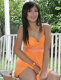 True Tere - Leggy dark-skinned teen latina wearing a very revealing orange dress
