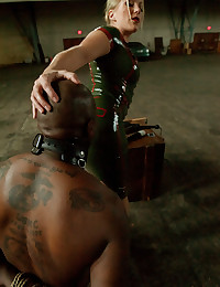 Rubber babe dominates black