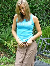 Only Melanie - In the backyard modeling her tan pantyhose for you
