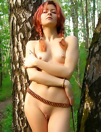 Erotic pigtailed redhead naked outdoors