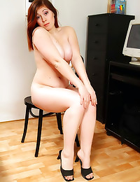 Curvy redhead has big tits