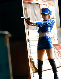 Asian police babe with gun