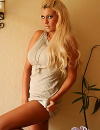 Dolled up blonde kitty in beautiful dress shows she is going commando