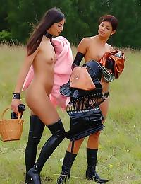 Kinky lesbian femdom play outdoors