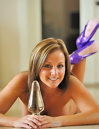 Melissa brings out her favorite glass dildos to play with.