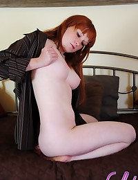 Busty ginger-haired girl give...