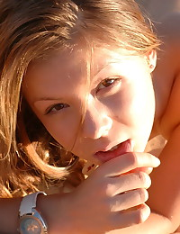 Emily 18 - Horny teen chick masturbating in the sand