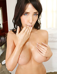 Busty Oiled Brunette Sucks Big Cock