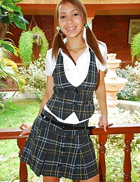Tania Spice - She's a sexy young schoolgirl in pigtails