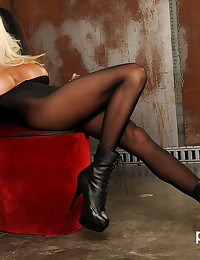 Blonde smokes and poses in a sexy black body stocking and masturbates