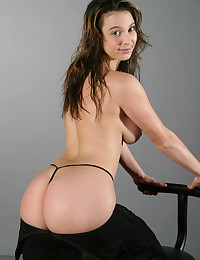Horny young gal posing in ele...