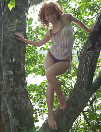 Red-haired nymph masturbating outdoors