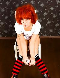 Pierced and tattooed redhead