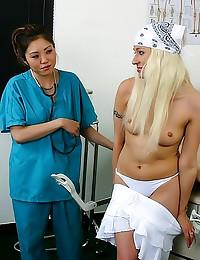 Gloved Asian nurse fingers gi...